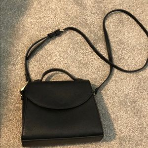 Mini black bag with gold details from target